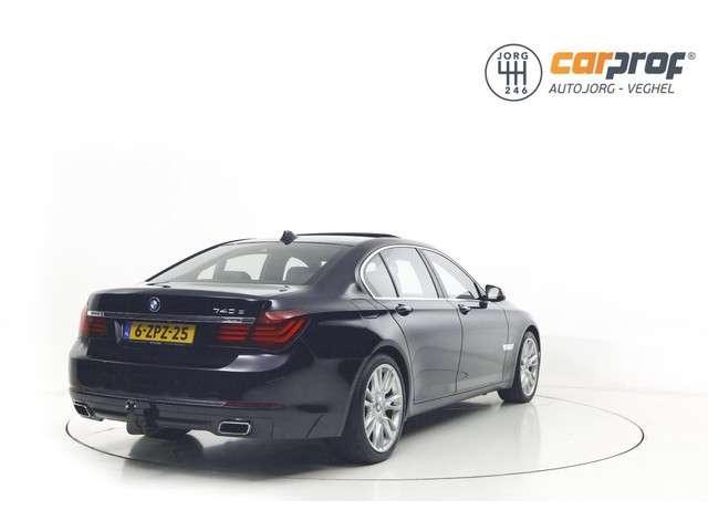 BMW 7-serie 740d Individual Edition Schuifdak Adaptive Cruise Camera HUB Harman Kardon Multi TV Schermen achter